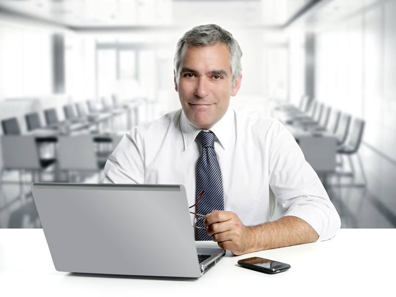 Businessman senior working interior modern office